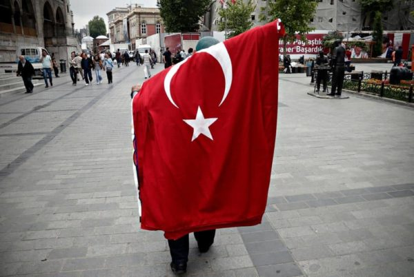 A man with a Turkish flag